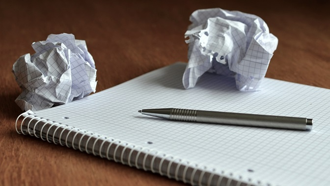 Notepad, pencil and paper ball